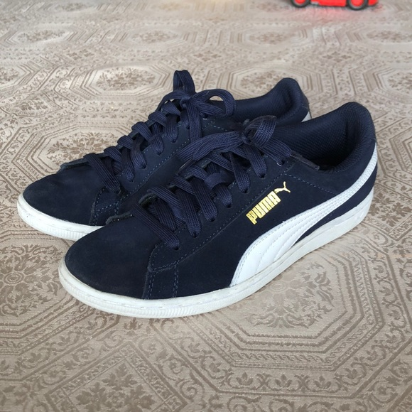 Navy blue and white Puma sneakers